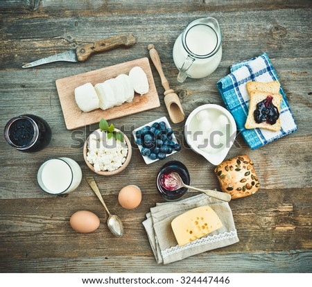 Summer breakfast. fruit and dairy products on a wooden table. top view - stock photo