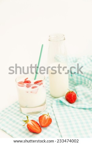 Summer breakfast: tasty ripe strawberries and fresh milk