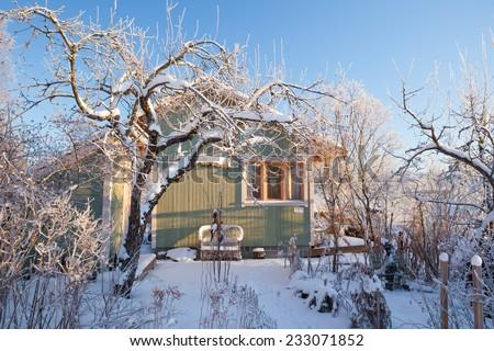 Summer cabin at winter - stock photo