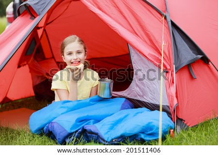 Summer Camp in the tent - young girl on the camping - stock photo