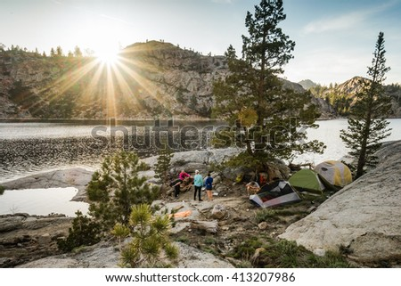 Summer camping by a mountain lake. - stock photo