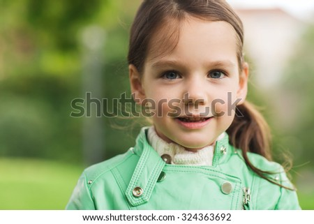 summer, childhood, happiness and people concept - happy beautiful little girl portrait outdoors - stock photo