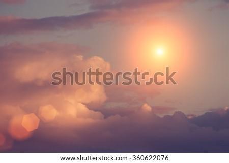 Summer cloudy sky with sun - stock photo