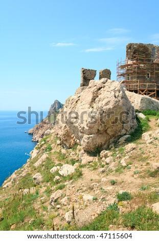 Summer coastline and view of ancient Genoese fortress (Near Balaclava Town, Crimea, Ukraine) - stock photo
