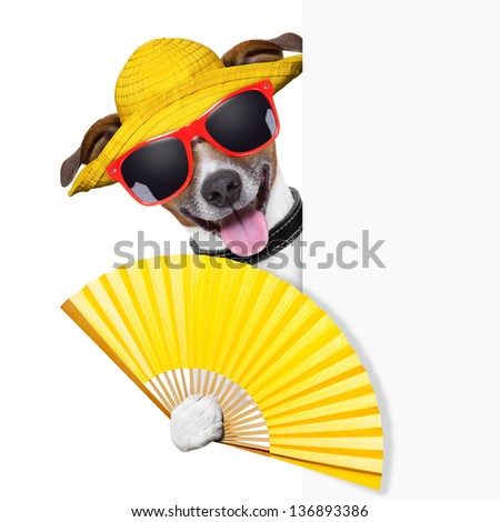 summer cocktail dog cooling off with hand fan behind banner