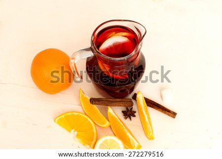 summer cocktail sangria with fruit in a basket. oranges, lemons, cinnamon - stock photo