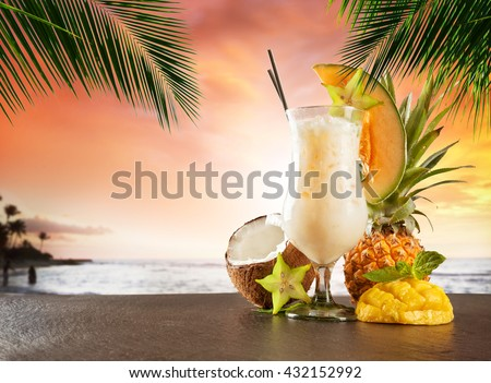 Summer cocktail with blur beach on background - stock photo