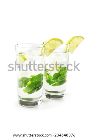 Summer cocktail with ice cubes isolated on white
