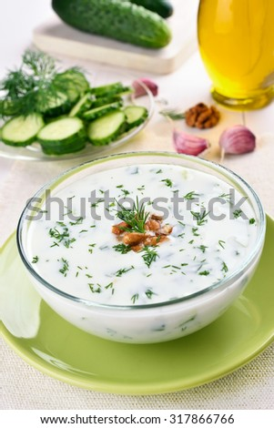 Summer cold soup with cucumbers, dill and walnut - stock photo