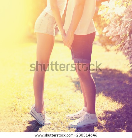Summer colorful sunny photo happy young couple in love kissing outdoors, bright warm colors - stock photo