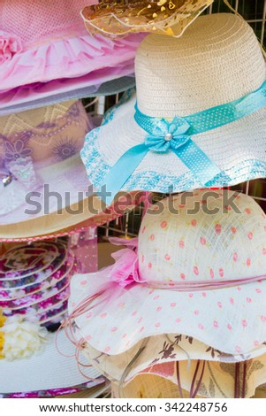 Summer colorful women's hats decorated with ribbons and stones