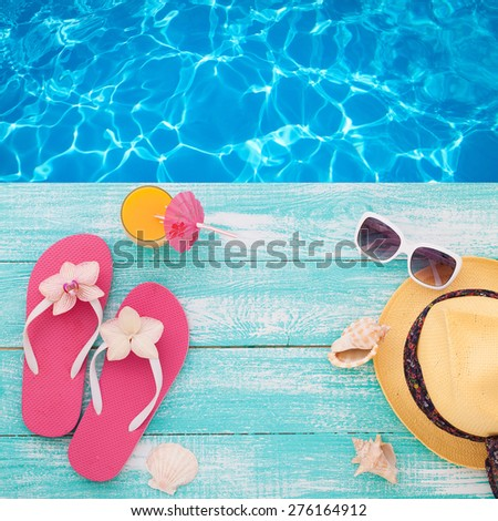 Summer concept of sandy beach, straw hat, shells and starfish. Flat design. Top view beach accessories mock up for design - stock photo