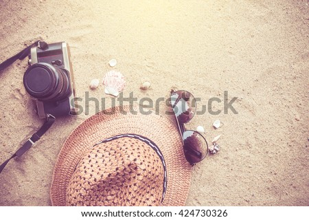 Summer concept with accessories on sand beach. - stock photo