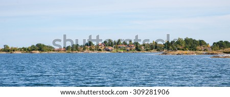 Summer cottages at the swedish east coast - stock photo