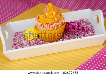 summer cupcake in pink and yellow with sprinkles - stock photo