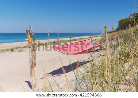 summer day at the beach, hammock in the dunes at sea
