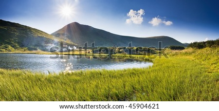 summer day at the lake in the mountains - stock photo