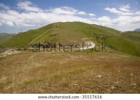 Summer day in Armenia, Mountain route blue sky. - stock photo