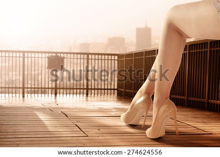 summer day in city and woman legs  - stock photo