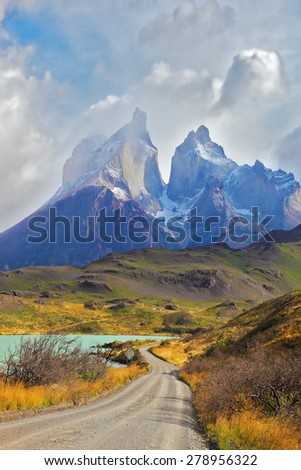 Summer day in the national park Torres del Paine, Patagonia, Chile. Cliffs of Los Kuernos among the clouds - stock photo