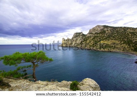 Summer day landscape with the sea and mountains