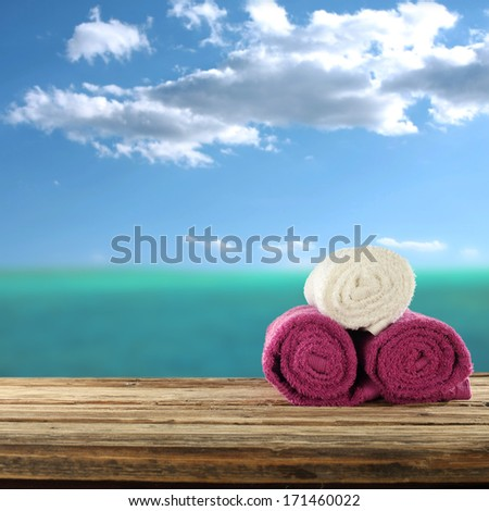 summer desk and towels  - stock photo