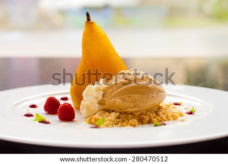 Summer dessert with poached pear, ice cream, whipped cream, fruits - stock photo