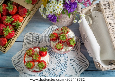 Summer dessert with strawberries and cream - stock photo