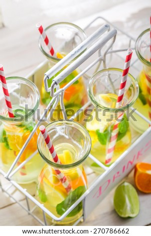 Summer drink with lemon and orange