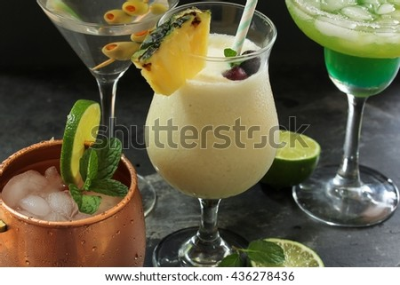 Summer drinks / Cocktails -Moscow Mule,Pina Colada ,Martini and Lime cocktail in one frame, selective focus - stock photo