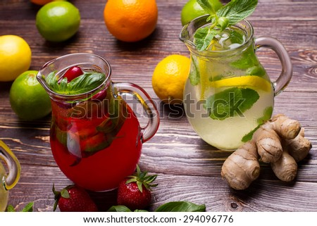 Summer drinks with ice, fresh berries and citrus fruits.  - stock photo