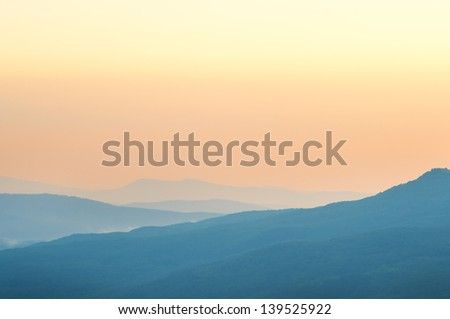 Summer early morning foggy mountains landscape