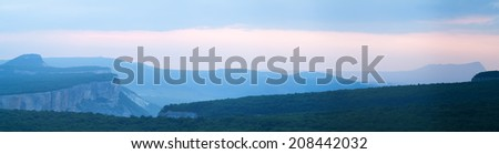 Summer early morning foggy mountains landscape - stock photo