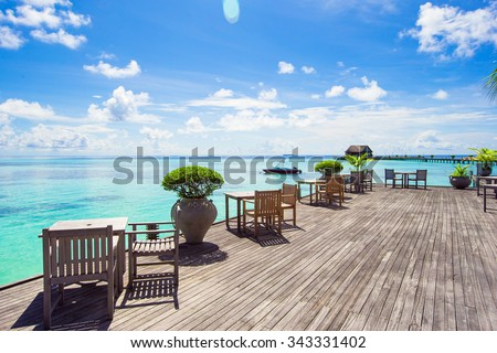 Summer empty outdoor cafe at beautiful tropical island - stock photo