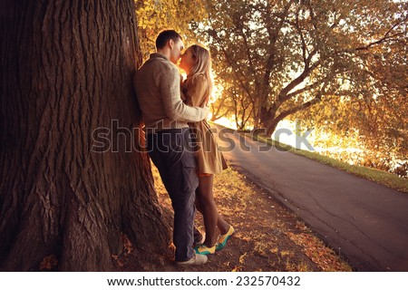 summer evening in love couple in the park sunbeams happiness - stock photo