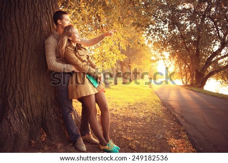 summer evening in love couple in the park sunbeams happiness