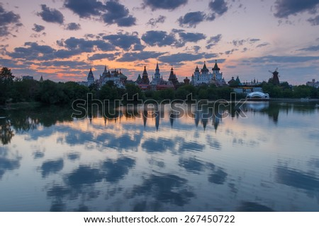 Summer evening landscape with russian Kremlin after sunset with interesting sky. Izmailovo Park and the Kremlin, Moscow, Russia - stock photo