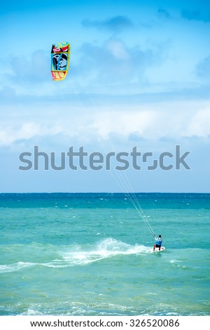 Summer extreme sports. Kite surf activity of professional athlete   - stock photo