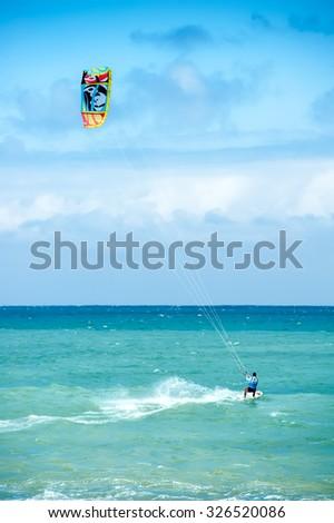 Summer extreme sports. Kite surf activity of professional athlete   - stock photo
