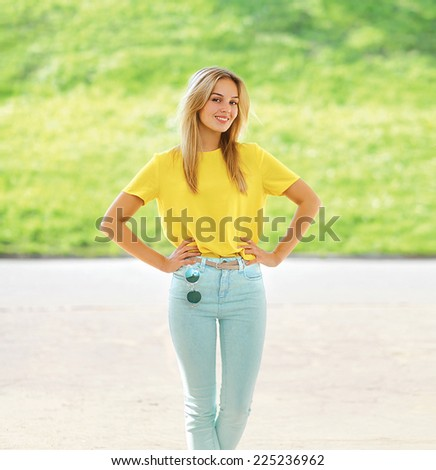 Summer, fashion and people concept - happy pretty woman posing in the city, street fashion - stock photo