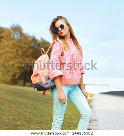Summer, fashion and people concept - pretty stylish hipster woman in the city park, cool roller girl posing outdoors - stock photo