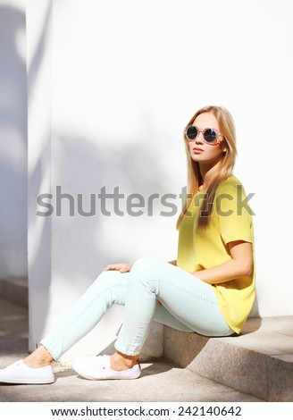 Summer, fashion and people concept - stylish hipster cool girl in sunglasses outdoors - stock photo