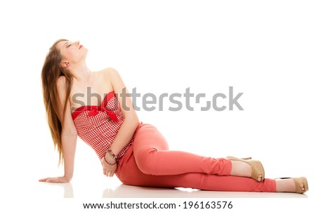 Summer fashion. Portrait of attractive woman teenage girl in red outfit sitting on the floor isolated on white - stock photo