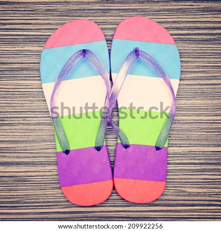 Summer flip flops  on wood background. Top view.