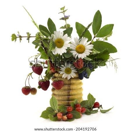 Summer flowers and berries in vase isolated  - stock photo