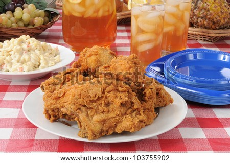 Summer foods, a fried chicken lunch on a picnic table - stock photo
