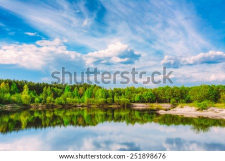 Summer Forest And River Under Blue Sky. River Water Nature Landscape - stock photo