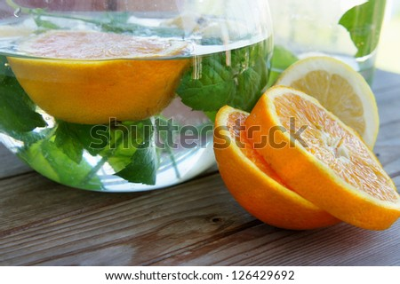 Summer fresh drink with oranges, lemons and mint - stock photo