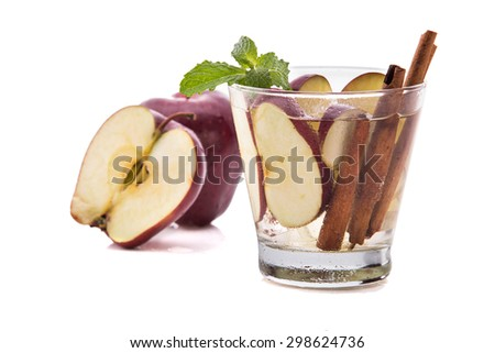 Summer fresh fruit Flavored infused water mix of apple and cinnamon isolated over white background - stock photo