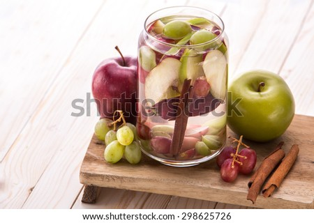 Summer fresh fruit Flavored infused water mix of  Apple, grape and cinnamon - stock photo